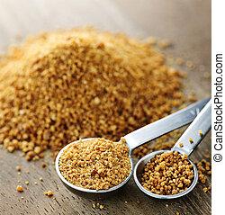 Coconut palm sugar in measuring spoons - Organic coconut...