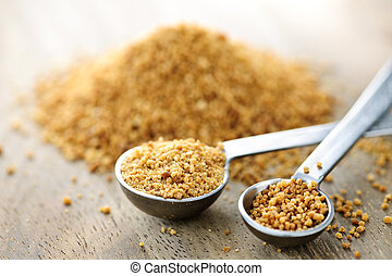 Coconut palm sugar in measuring spoons - Organic coconut...