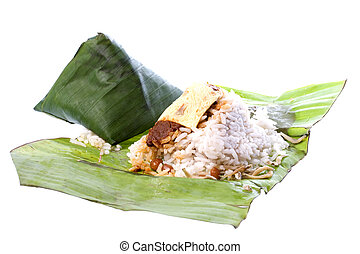 Isolated image of rice cooked in coconut milk and packed in banana leaf, commonly known as Nasi Lemak. This Malaysian delicacy is served with spicy paste, anchovies, groundnuts, cucumber slices, and is usually taken in the morning for breakfast.
