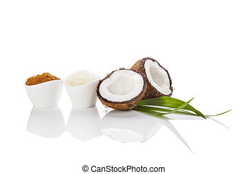 Coconut sugar and oil on white background