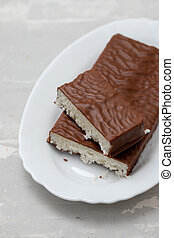 coconut turron with chocolate on a ceramic background