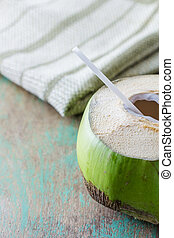 Coconut water drink on the table background