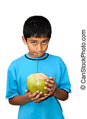 Coconut Water - An handsome Indian kid drinking coconut...
