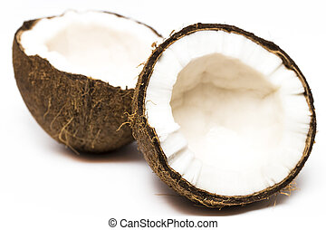 Coconut with a half on white background, closeup