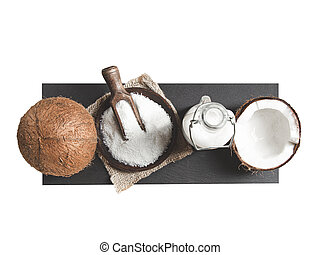Coconuts, coconut milk and grated coconut on white background. Top view.
