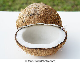 Coconuts on the white isolated over blurred grass background