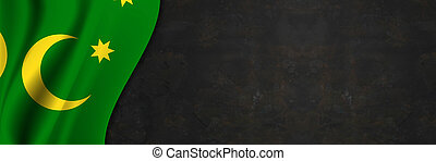 Cocos Islands flag on concrete wall. Banner with fabric texture of the flag of Cocos Islands