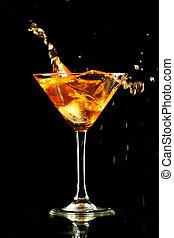 coctail splash - alcohol splash in martini glass on black ...