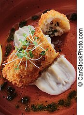 cod croquette - cod fish croquette plated meal