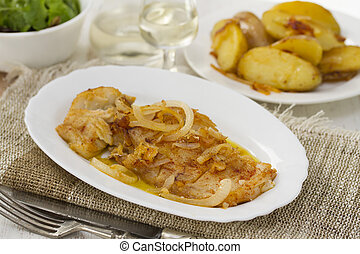 cod fish with potato on white dish