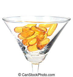 Cod liver oil capsules in martini glass