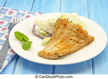 Cod with tomato and vegetable sauce