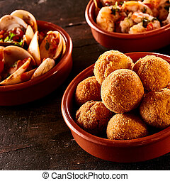 Codfish bacalao croquettes covered in bread crumbs and fried...