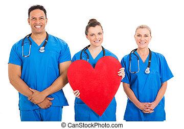 coeur, collègues, jeune, forme, tenue, infirmière