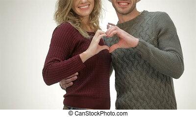 coeur, couple, jeune, forme, tenant mains