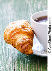 Cofee and croissant - Cup of coffee and croissant on green ...