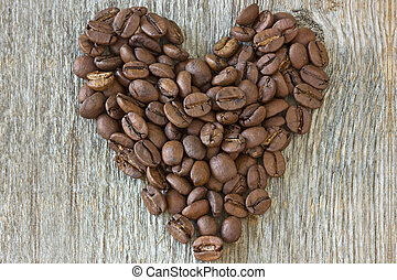 coffe beans heart on wood background