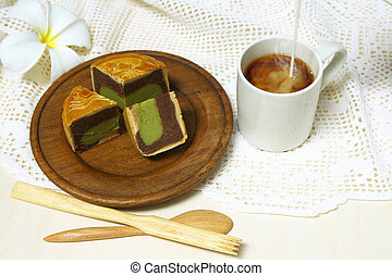 Coffe cup and moon cake serve on wooden dish