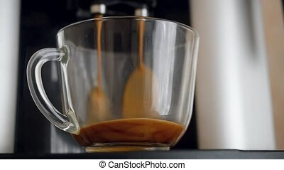 coffe dispenser with cup of coffee. Slowmotion pour - coffe...