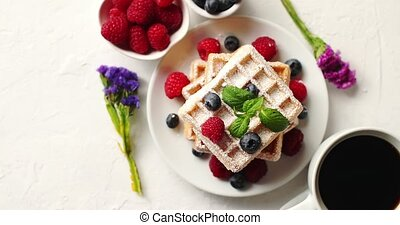 Coffee and berries near waffles - From above shot of cup of...