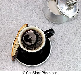 Coffee and biscotti with sugar