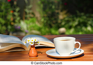 Coffee and book in garden
