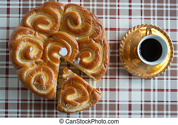 Coffee and Brioche on table