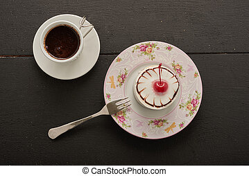 coffee and cake with cherry top