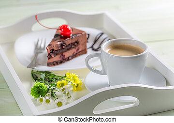 Coffee and chocolate cake with cherries