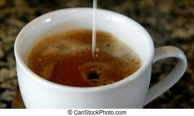 Coffee and Cream - Fresh Coffee with Cream being poured in