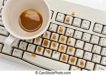 Coffee and damaged computer keyboard close up