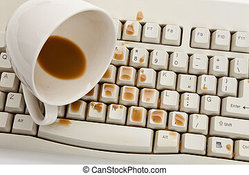 Coffee and damaged computer keyboard