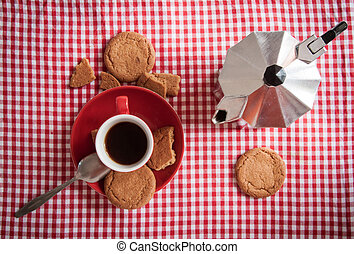 Coffee and ginger biscuits.