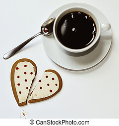 coffee and heart-shaped cookie