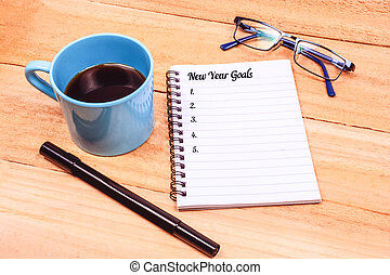 Coffee and notebook with goals for 2019