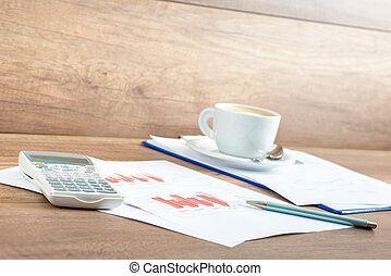 Coffee and paperwork on an office desk