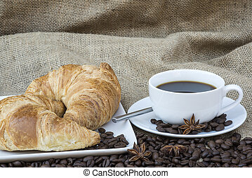 Table setting for continental breakfast of coffee and pastries