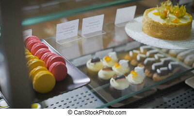 Coffee and pastry bar. Counter. On a glass surface desserts...