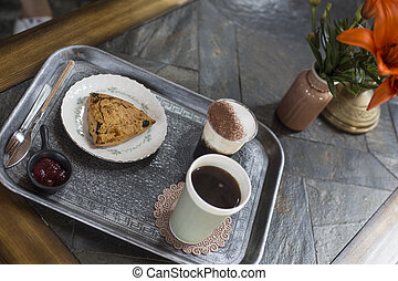 Coffee and Scones on a silver tray.