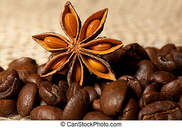 Coffee and Star Anise on sackcloth with copyspace - Coffee...