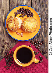 Coffee and tasty cupcake with nuts