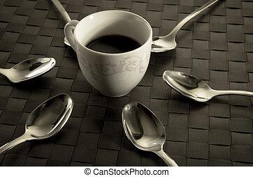 Coffee and teaspoons still life