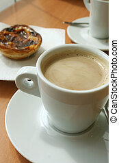 coffee and treat - taking a coffee break with pastry