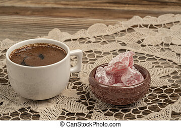 coffee and turkish delight on a wooden table with copy space...