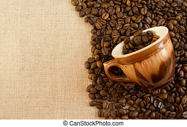 coffee background - Coffe and cup on a fabric background.