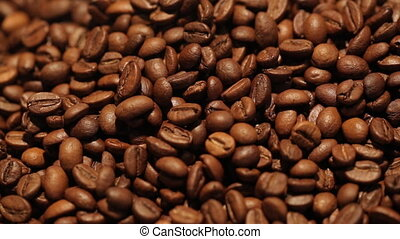 Coffee bean background. Sliding camera - Coffee bean...