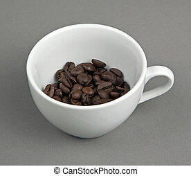 Coffee bean in white cup on gray background.