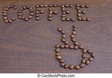 Coffee bean in white cup with on wooden board