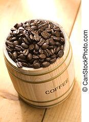 Coffee bean in oak drum sitting on wood floor