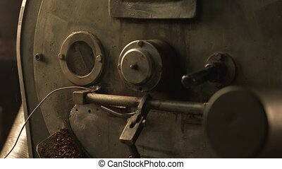 Coffee bean roaster at work in a production room